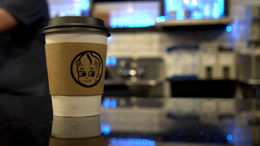 A Coffee sits on the counter at Golden Boy Coffee