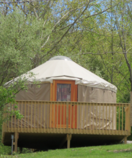 photo of yurt at aj jolly park in Alexandria ky with green trees and green grass in springtime