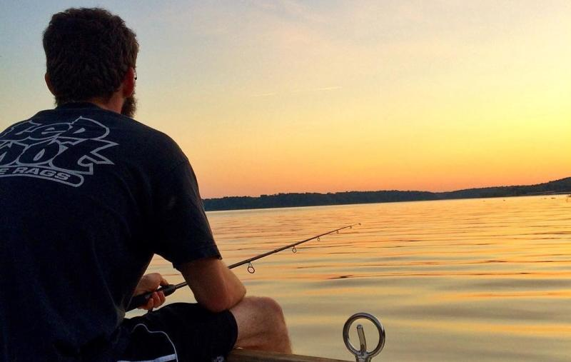 Fishing on a boat in Monroe Lake