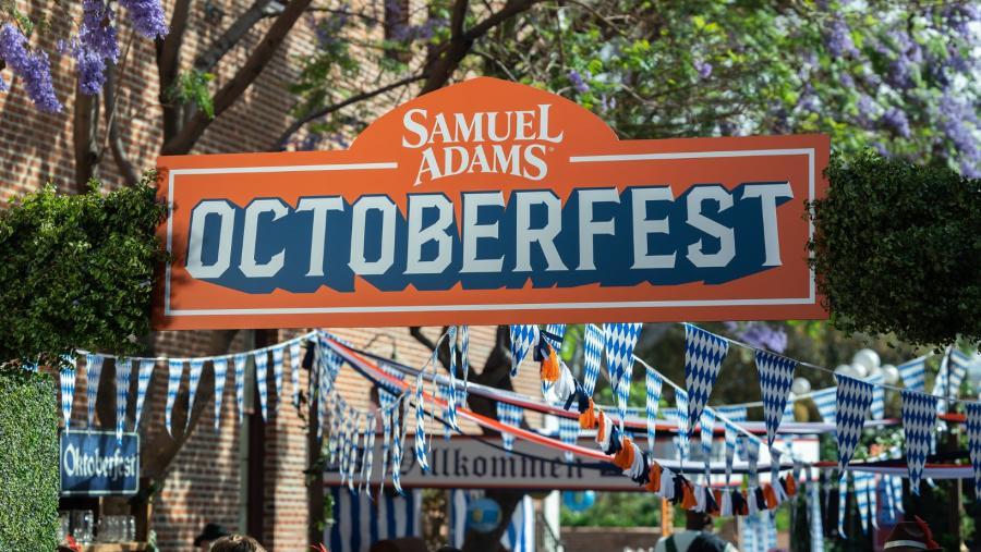 A banner hangs over a walkway that says Samuel Adams Octoberfest