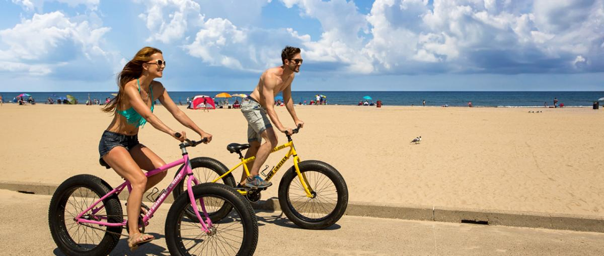 Couple biking by the beach