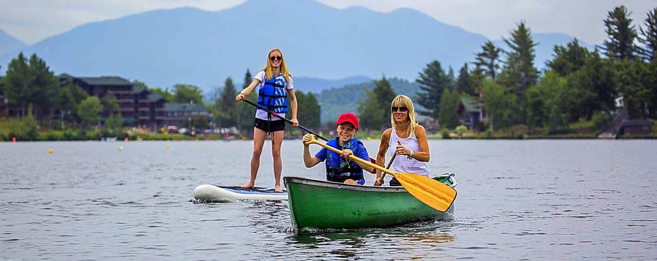 People in canoe on Lake Placid and Mirror Lake