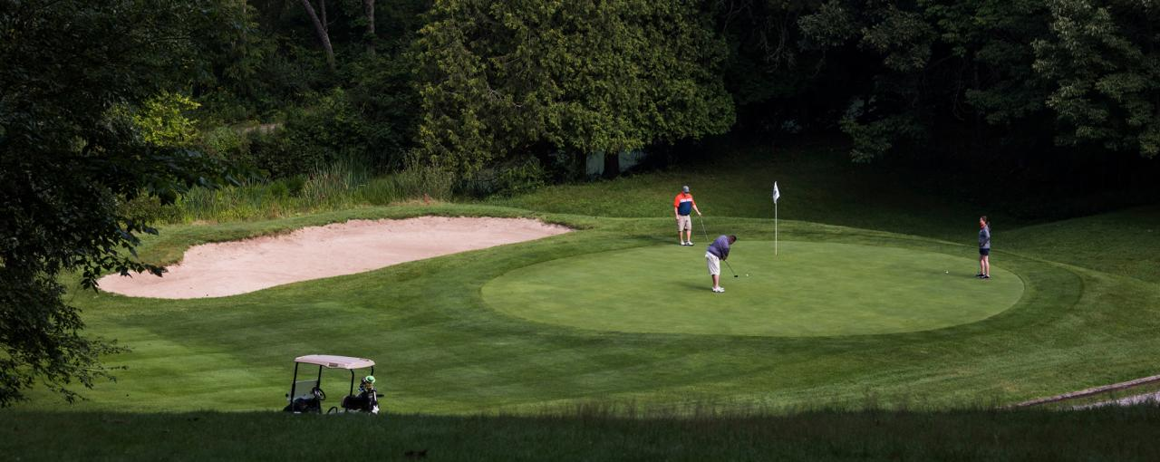 A picture of three men playing golf at Chenango Valley State Park Golf Course