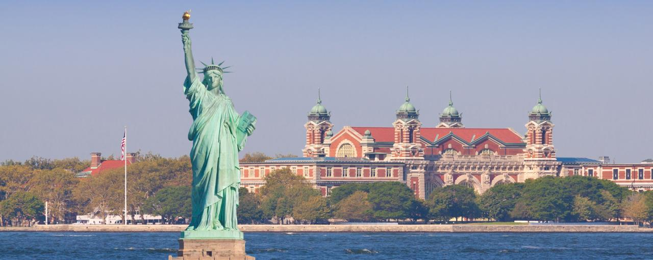 Ellis Island and the Statue of Liberty on a sunny day in New York City