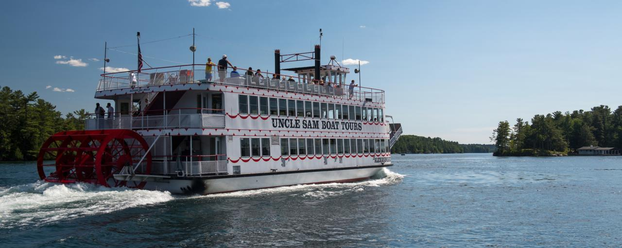 A picture of a white and red double-decker boat on the Uncle Sam Boat Tour