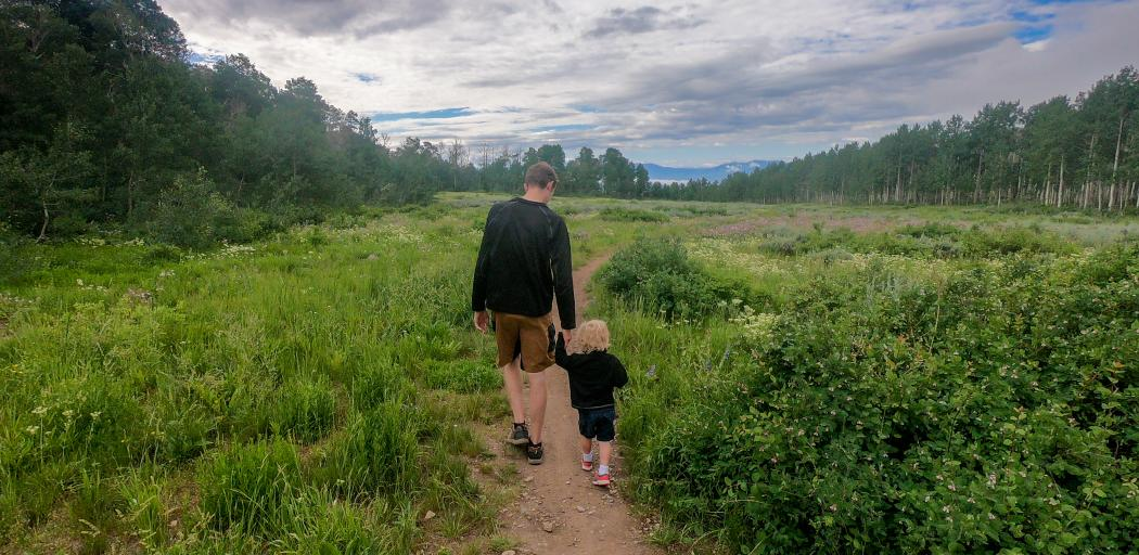 Father and son walking on a hiking trail
