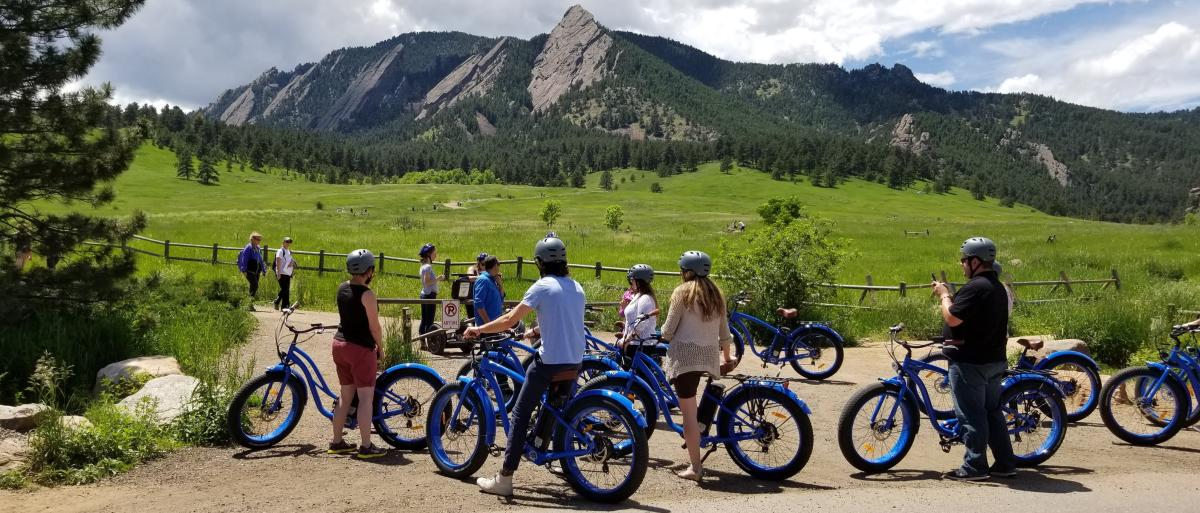 Group stopped to look at the Flatirons during a Electric Cruiser Bike Tour in Boulder
