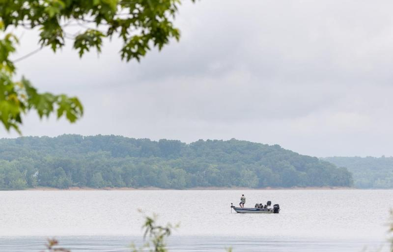 A man fishing on Monroe Lake in the Hoosier National Forest