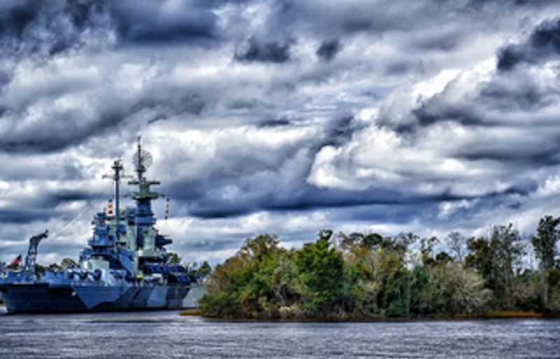 The Battleship North Carolina sitting in the waters of Wilmington, NC
