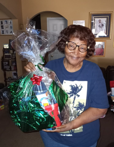 Lead by Example photo of woman with gift