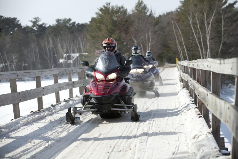 Friends snowmobiling in Minocqua, WI