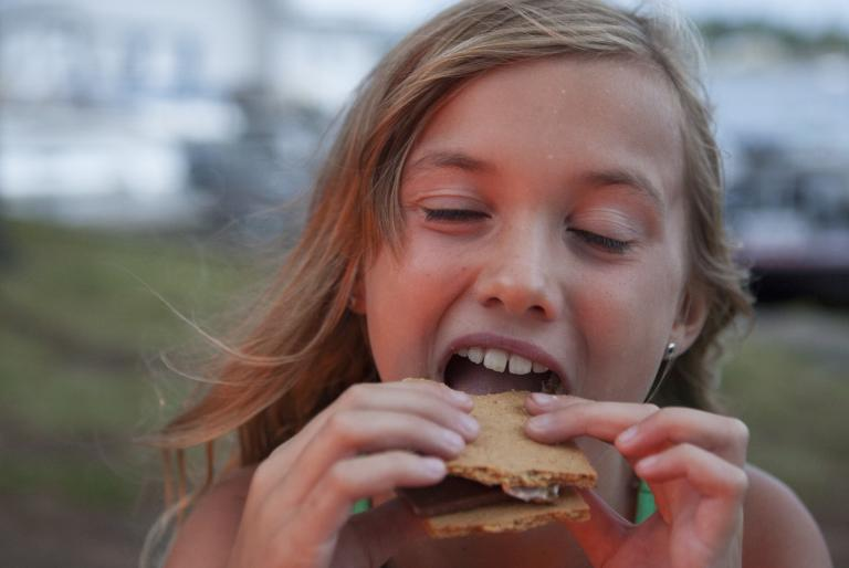 Girl Eating A S'More