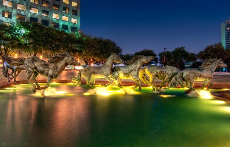Mustangs of Las Colinas outdoor sculpture at night