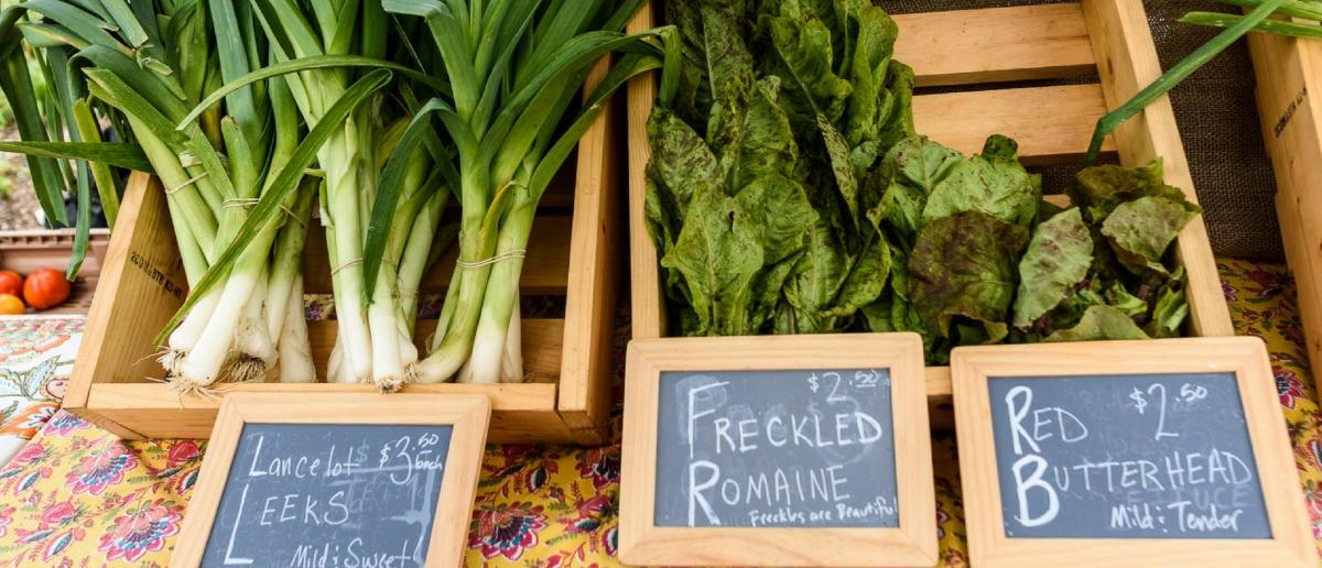 Leeks and lettuce for sale at the Clayton Farm & Community Market, Clayton NC.