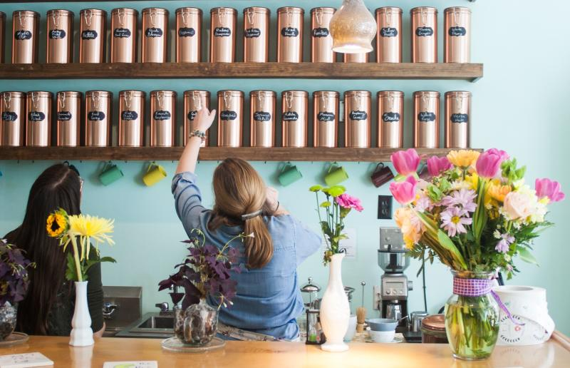 Two baristas searching for tea at Cup & Kettle