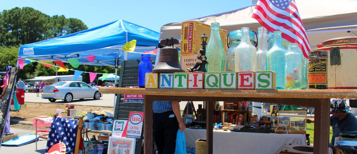301 Endless Yard Sale collectable bottles and blocks spelling the word antiques.