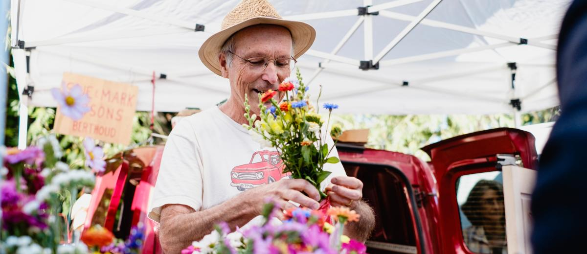Boulder Farmers Market Man with flowers