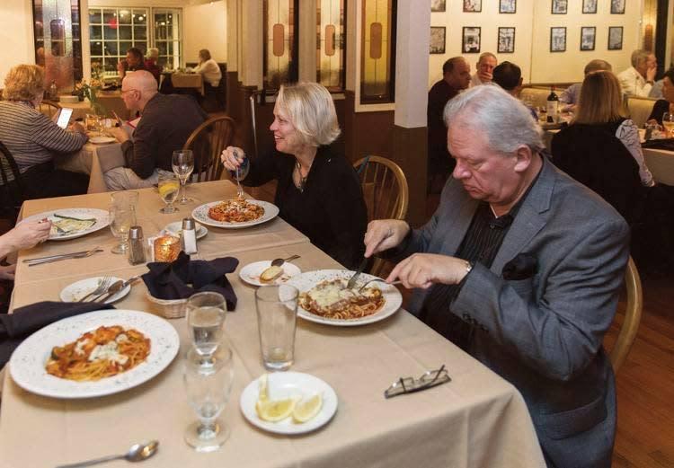 Couples having dinner inside D'Rocco's dining room
