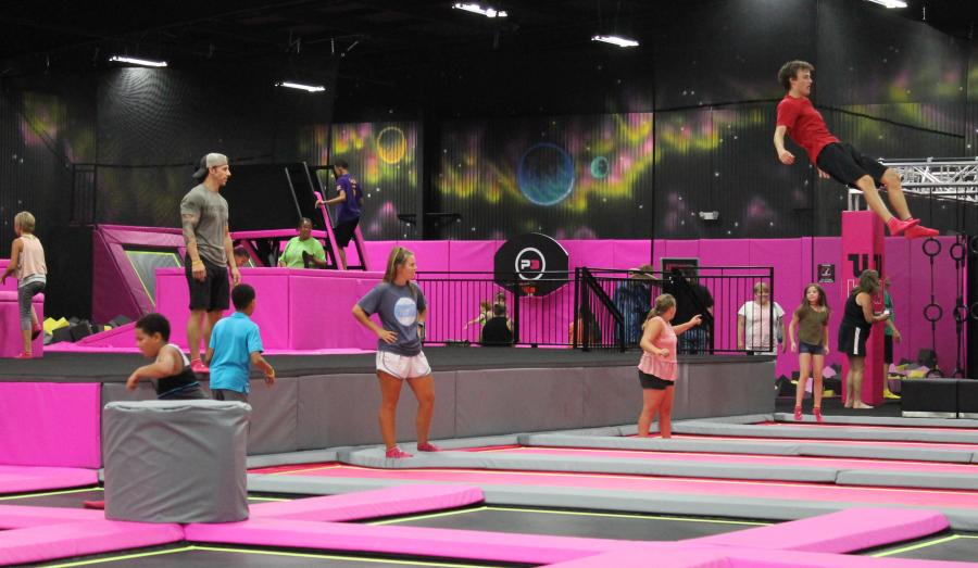 kids jumping at an indoor trampoline park