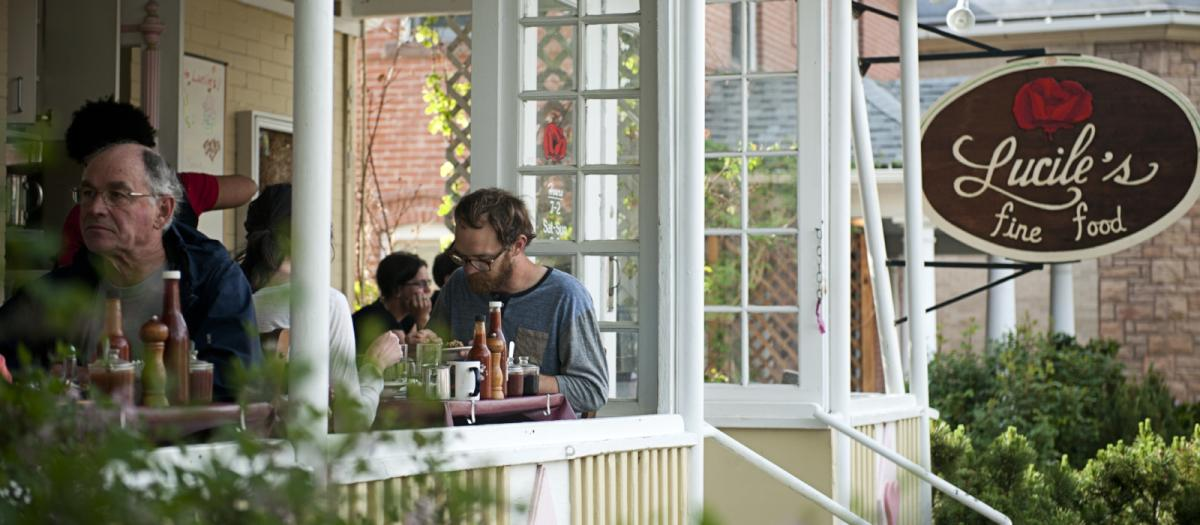 People dining on the outdoor patio at Lucile's Boulder
