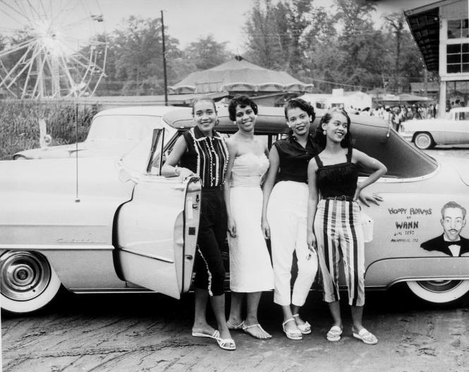 Carr's Beach, four women in front of Hoppy Adam's  car.