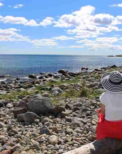 Woman overlooking sea at Bjellandstrand beach
