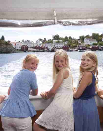 Children onboard ferry with island in the background