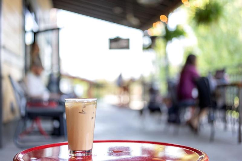 An iced latte on the patio at Hopscotch Coffee
