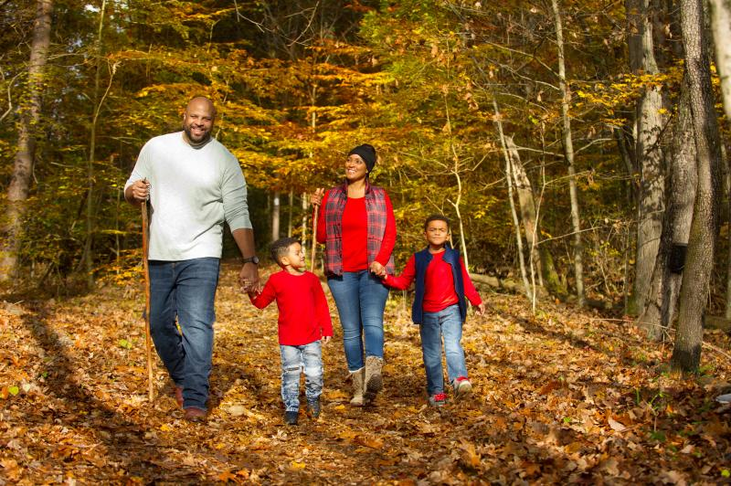 Family hiking in the woods at Deam Lake Knobstone Trail