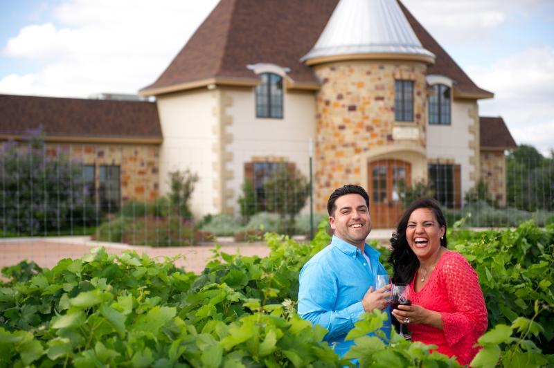 Visitors enjoy a wine tasting event at Messina Hof Winery in Fredericksburg, TX.