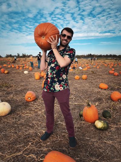 A man holds his Halloween pumpkin at Huber's Pumpkin Patch.