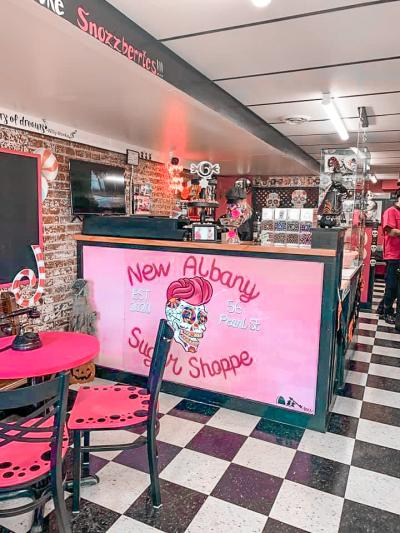 New Albany Sugar Shoppe counter display, near brightly colored tables and chairs.