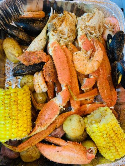The Fish House Grill cooking a seafood boil
