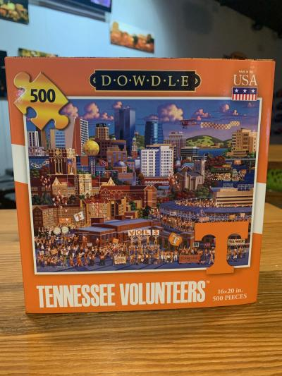 The 500-piece Tennessee Volunteers Puzzle features an illustration of the Knoxville skyline.