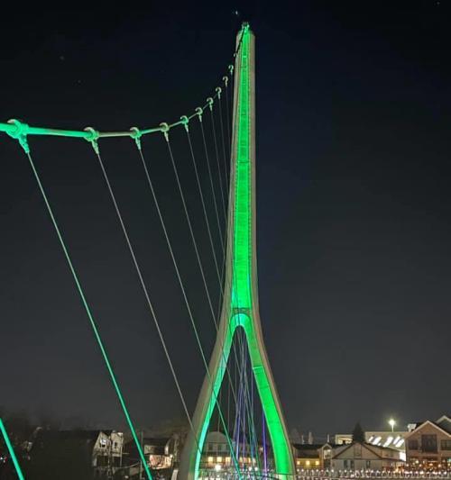 Dublin Link pedestrian bridge lit green at night