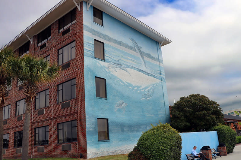 Artist Wyland painted these dancing dolphins on the wall of Wilmington's Best Western Plus Coastline Inn.