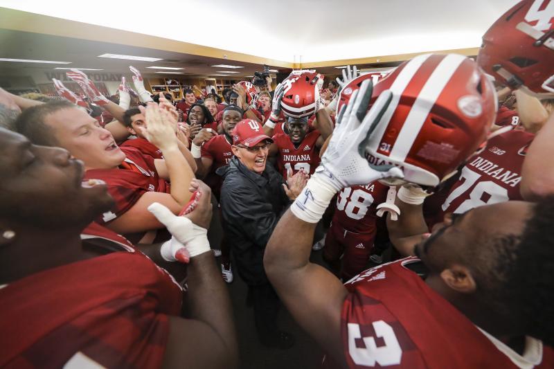 The IU football team huddling in the locker room