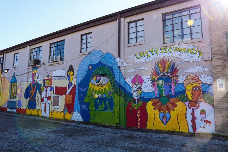 """""""Unity is Community"""" Mural along Artisan Alley"""