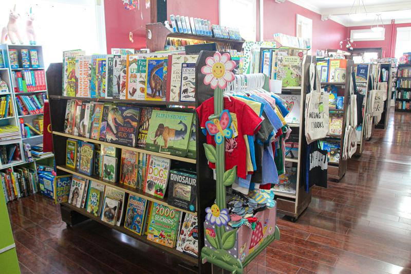 A section of children's books and other items at Book Corner
