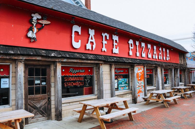 The exterior of Cafe Pizzaria greets visitors with a beloved vintage vibe.