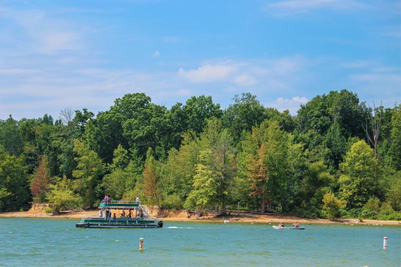 A pontoon and two kayaks on Monroe Lake at the Paynetown SRA