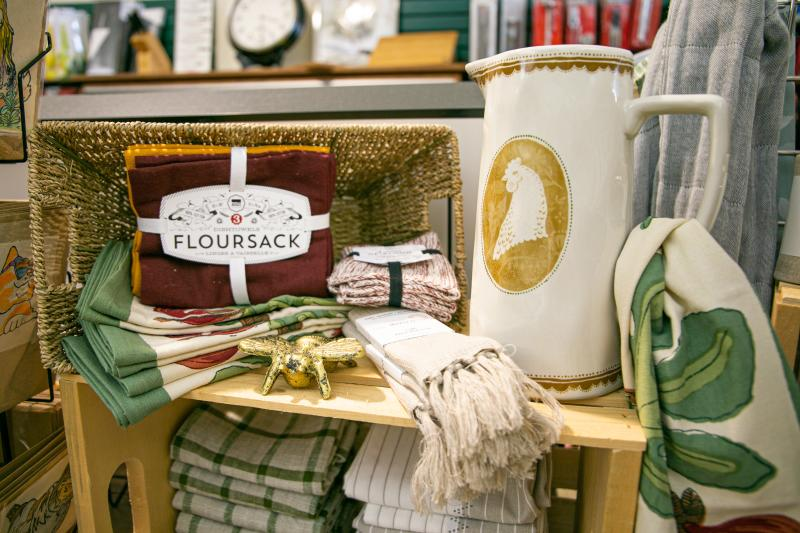 Display of tea towels and a pitcher at Goods for Cooks