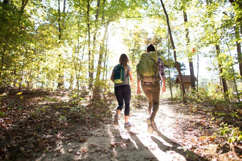 Two people hiking at Monroe Lake