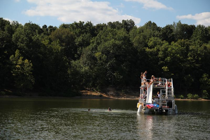 Group of people on a double decker pontoon rental at Lake Monroe