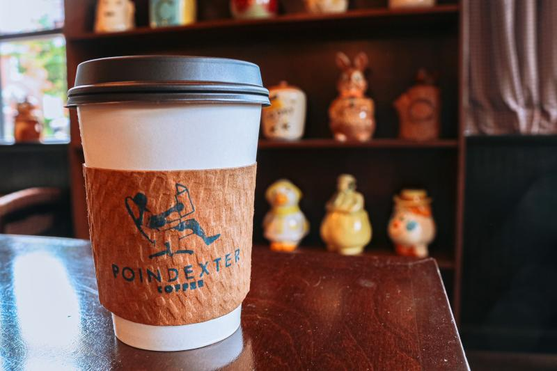 A to-go latte from Poindexter Coffee