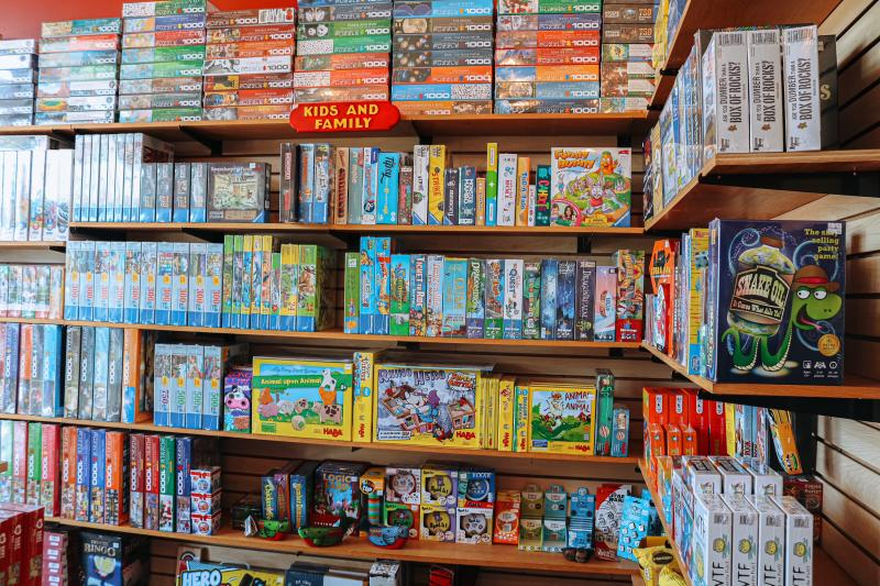Section of kids & family games at The Game Preserve