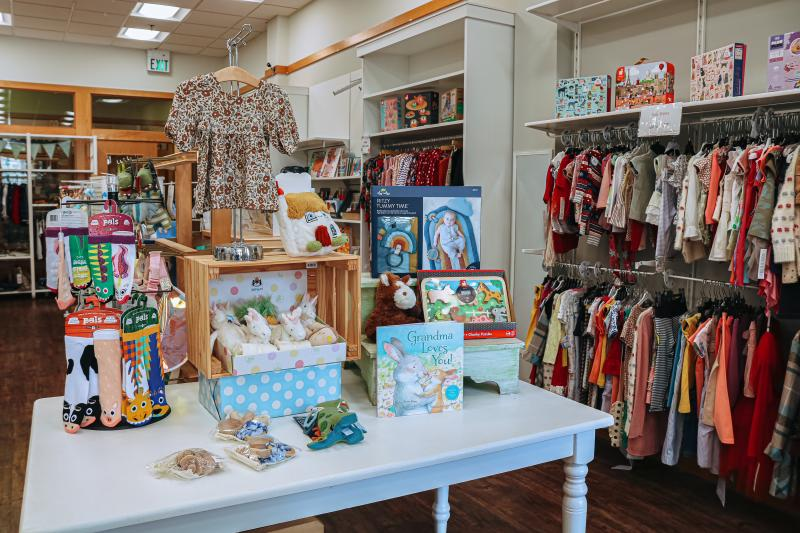Displays of children's items for sale at O'Child Children's Boutique