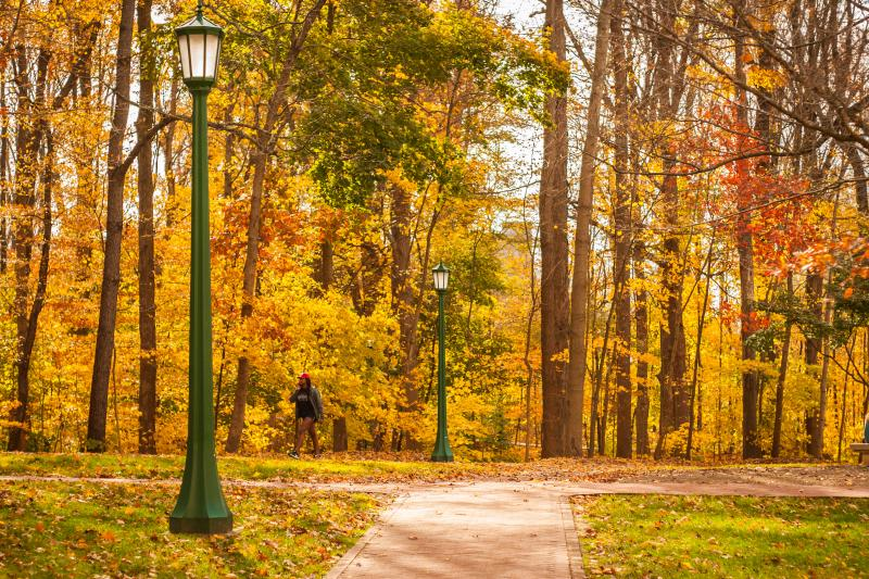 Man walking in IU'S Old Crescent during fall
