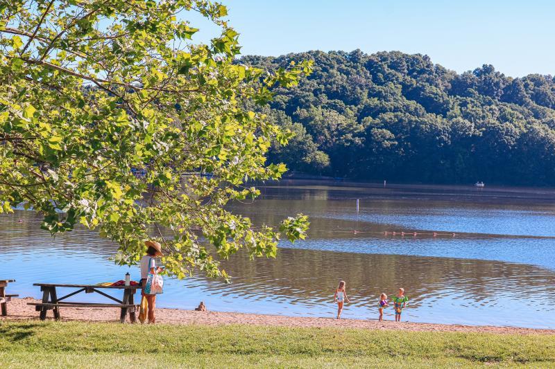 Kids playing on the beach at Lake Lemon