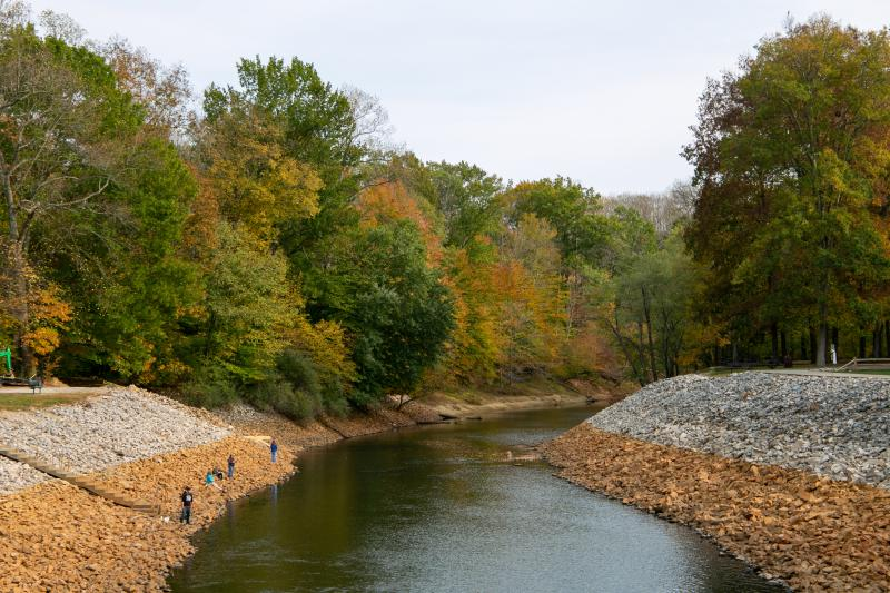 People fishing at the Monroe Lake Spillway during fall